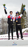 Sochi, RUSSIA - Mar 16 2014 - Brian McKeever and his guide Erik Carleton receive their gold medal for Cross Country Skiing Men's 10km Free Visually Impaired at the 2014 Paralympic Winter Games in Sochi, Russia.  (Photo: Matthew Murnaghan/Canadian Paralympic Committee)