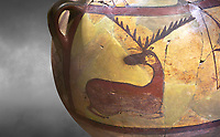 Close up of a Phrygian terra cotta large jug with handles, decorated with animals, from Gordion. Phrygian Collection, 6th century BC - Museum of Anatolian Civilisations Ankara. Turkey. Against a grey background