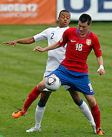 Nikola Ninkovic (C) competes for the ball with Jordan Cousins of England during the UEFA U-17 championship Group A match between Serbia and England on May 9, 2011 in Indjija, Serbia (Photo by Srdjan Stevanovic/Starsportphoto.com)
