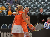 Februari 08, 2015, Apeldoorn, Omnisport, Fed Cup, Netherlands-Slovakia, doubles, Dutch team Michealla Krajicek and Richel Hogenkamp (R) celebrate the 4-1 win over Slovakia<br /> Photo: Tennisimages/Henk Koster