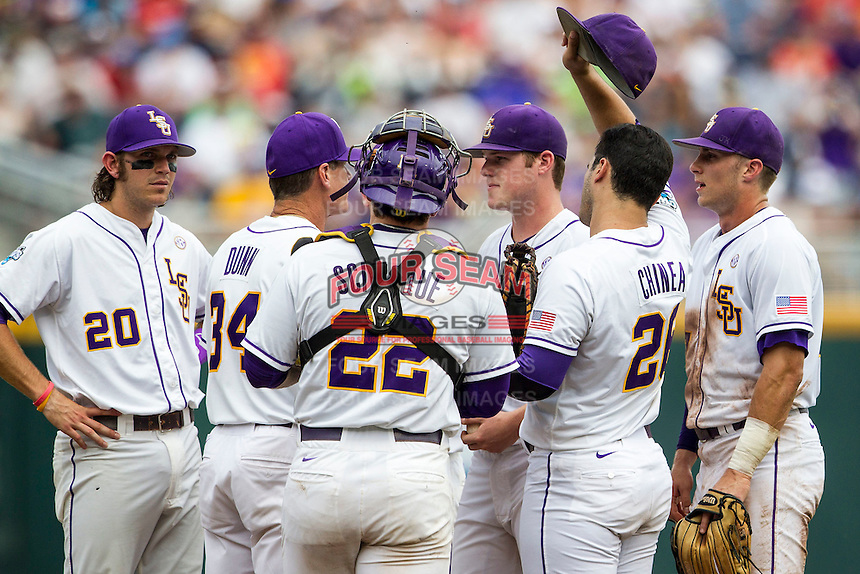 LSU Tigers infielders listen as pitching coach Alan Dunn (34) talks with pitcher Jared Poche (16) on the mound against the TCU Horned Frogs in the NCAA College World Series on June 14, 2015 at TD Ameritrade Park in Omaha, Nebraska. TCU defeated LSU 10-3. (Andrew Woolley/Four Seam Images)