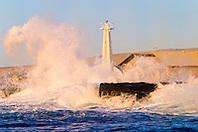 big ocean waves, pounding on lava rocks and lighthouse at Keahole Point, NELHA Facility behind, Kona Coast, Big Island, Hawaii, USA, Pacific Ocean