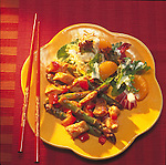 plate with lemon chicken stir-fry with salad greens