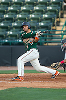 Justin Twine (1) of the Greensboro Grasshoppers follows through on his swing against the Hickory Crawdads at L.P. Frans Stadium on May 6, 2015 in Hickory, North Carolina.  The Crawdads defeated the Grasshoppers 1-0.  (Brian Westerholt/Four Seam Images)