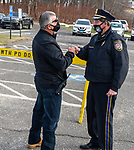 WATERTOWN, CT-123020JS01- Wolcott Police Chief Edward Stephens, left, congratulates Watertown Police Chief John Gavallas  during a send-off parade and ceremony in his honor of Wednesday at the Watertown Police Department. Chief Gavallas has served for 51 years. <br /> Jim Shannon Republican-American