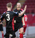 Clyde's Pat Scullion celebrates with Gavin Brown (3) after he scores Clyde's first goal.