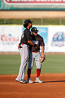 Chattanooga Lookouts shortstop Jose Barrero (34) shares a hug with second baseman Leonardo Rivas (3) during the game against the Tennessee Smokies at Smokies Stadium on June 18, 2021, in Kodak, Tennessee. (Danny Parker/Four Seam Images)