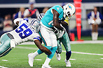 Dallas Cowboys middle linebacker Anthony Hitchens (59) in action during the pre-season game between the Miami Dolphins and the Dallas Cowboys at the AT & T stadium in Arlington, Texas.