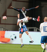 Jozy Altidore battles for a ball in the air..The USA men fell to the Netherlands 2-1 at Amsterdam ArenA, Wednesday, March 3, 2010.