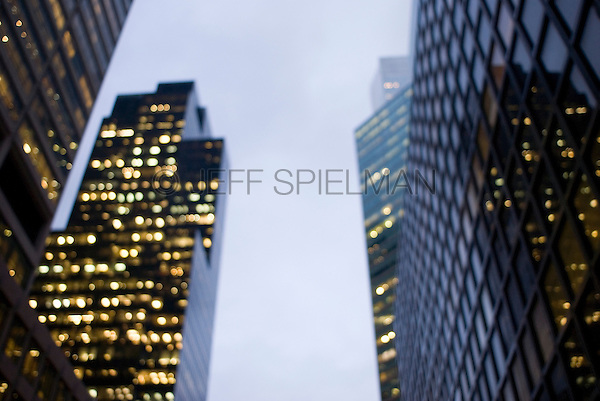 AVAILABLE FROM GETTY IMAGES FOR COMMERCIAL AND EDITORIAL LICENSING.  Please go to www.gettyimages.com and search for image # 115925721.<br /> <br /> Illuminated Office Buildings at Dusk, Defocussed View, Lexington Avenue-Midtown Manhattan, New York City, New York State, USA