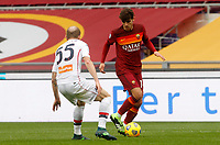 Roma's Gonzalo Villar , right, is challenged by Genoa's Andrea Masiello during the Italian Serie A Football match between Roma and Genoa at Rome's Olympic stadium, March 7, 2021.<br /> UPDATE IMAGES PRESS/Riccardo De Luca
