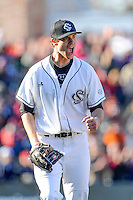 Pitcher Jack Wynkoop (13) of the South Carolina Gamecocks shouts and pumps his fist after retiring the side with the bases loaded in the sixth inning of the Reedy River Rivalry game against the Clemson Tigers on Saturday, February 28, 2015, at Fluor Field at the West End in Greenville, South Carolina. South Carolina won, 4-1, and Wynkoop got the win. (Tom Priddy/Four Seam Images)