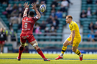 22nd May 2021; Twickenham, London, England; European Rugby Champions Cup Final, La Rochelle versus Toulouse; Ihaia West of La Rochelle kicks the ball over Jerome Kaino of Toulouse