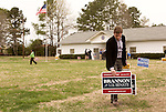 April 6, 2014. Durham, North Carolina.<br />  Michael Couvillion,a campaign volunteer, put up signs for Greg Brannon, one of eight Republican candidates running for Democrat Kay Hagan's Senate seat.<br /> As the the primary scheduled for May 6th grows near, several of the the eight Republican candidates running for the US Senate seat of incumbent Democrat Kay Hagan have increased their public visibility, appearing at events such as the Durham County Lincoln Douglas Lunch, where each candidate was given a few minutes to address the gathered Republican friendly crowd.