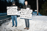 Men dressed as Edward Snowden and VATman protest near the roadway before Texas senator and Republican presidential candidate Ted Cruz speaks at a town hall at The Alpine Grove banquet center in Hollis, New Hampshire. VATman is a reference to Cruz's idea for a flat tax, which many opponents believe is really a value-added tax. The two men declined to be identified but said they do not support Ted Cruz.