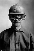 Chain screens on steel helmet to protect soldier's eyes from fragments of shell, rock, etc; manufactured by E. J. Codd Co., Baltimore, Md.  Ca.  1918.  E. J. Codd Co. (War Dept.)<br /> Exact Date Shot Unknown<br /> NARA FILE #:  165-WW-192B-3<br /> WAR & CONFLICT BOOK #:  581