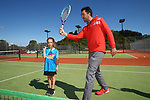 NELSON, NEW ZEALAND - SEPTEMBER 23: Evie Kidson receives some coaching from Nelson Head Coach Nick Caton at the Open Day Tennis on September 23 2017 in Nelson, New Zealand. (Photo by: Evan Barnes Shuttersport Limited)