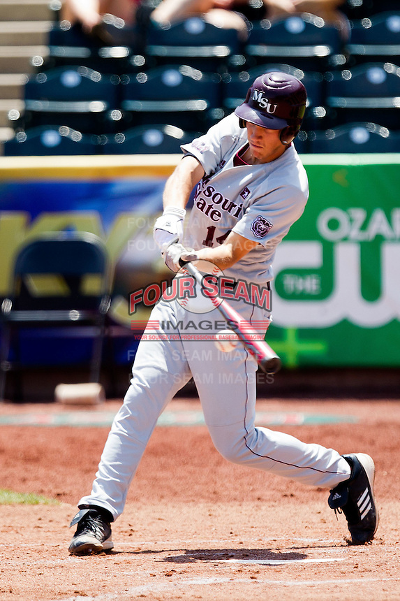 Eric Cheray (14) of the Missouri State Bears makes contact on a pitch during a game against the Wichita State Shockers in the 2012 Missouri Valley Conference Championship Tournament at Hammons Field on May 23, 2012 in Springfield, Missouri. (David Welker/Four Seam Images)
