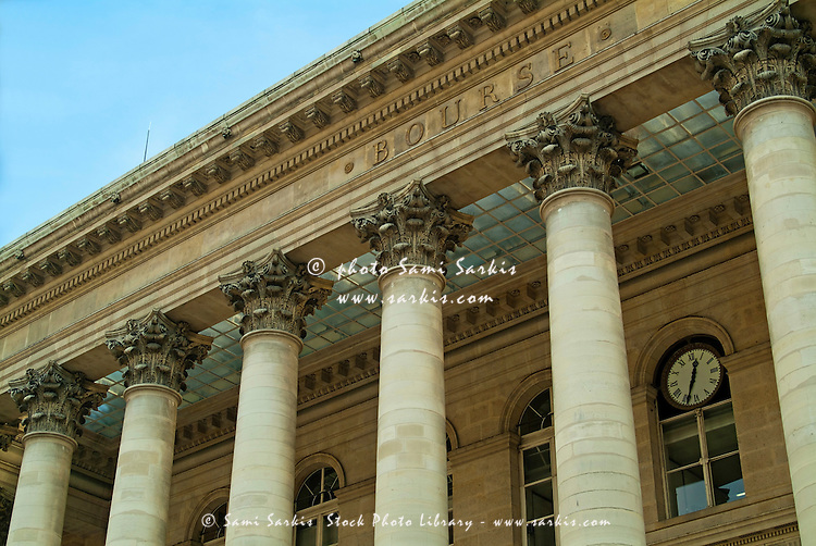 Windows and ornate columns outside Paris Bourse (Stock Exchange Building), Paris, France.