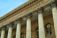 Windows and ornate columns outside Paris Bourse (Stock Exchange Building), Paris, France.