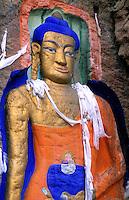 Painting artwork of Buddha on the Rock at Sakyamuni in capital city of Lhasa Tibet China