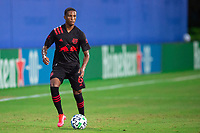LAKE BUENA VISTA, FL - JULY 22: Kyle Duncan #6 of the New York Red Bulls dribbles the ball during a game between New York Red Bulls and FC Cincinnati at Wide World of Sports on July 22, 2020 in Lake Buena Vista, Florida.