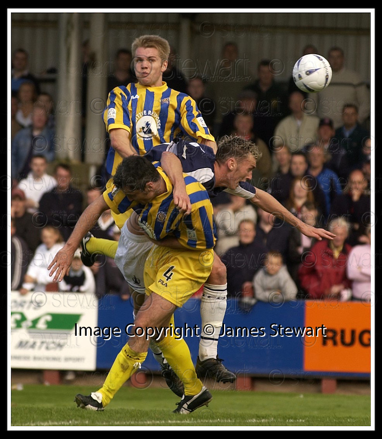 31/8/02       Collect Pic : James Stewart                     .File Name : stewart-falkirk v qots 21.LEE MILLER IS CHALLENGED BY ROBBIE NIELSON AND DEREK ALLAN.....James Stewart Photo Agency, 19 Carronlea Drive, Falkirk. FK2 8DN      Vat Reg No. 607 6932 25.Office : +44 (0)1324 570906     .Mobile : + 44 (0)7721 416997.Fax     :  +44 (0)1324 570906.E-mail : jim@jspa.co.uk.If you require further information then contact Jim Stewart on any of the numbers above.........