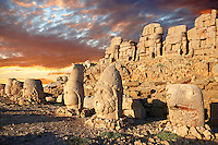 Pictures of the statues of around the tomb of Commagene King Antochus 1 on the top of Mount Nemrut, Turkey. Stock photos & Photo art prints. In 62 BC, King Antiochus I Theos of Commagene built on the mountain top a tomb-sanctuary flanked by huge statues (8–9 m/26–30 ft high) of himself, two lions, two eagles and various Greek, Armenian, and Iranian gods. The photos show the broken statues on the  2,134m (7,001ft)  mountain. 5