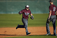 Concord Mountain Lions right fielder Richard Ortiz (16) runs off the field after the final out against the Wingate Bulldogs at Ron Christopher Stadium on February 2, 2020 in Wingate, North Carolina. The Mountain Lions defeated the Bulldogs 12-11. (Brian Westerholt/Four Seam Images)