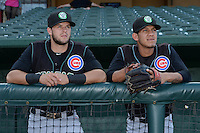 Kane County Cougars third baseman David Bote (5) and shortstop Carlos Penalver (6) before a game against the Peoria Chiefs on June 2, 2014 at Dozer Park in Peoria, Illinois.  Peoria defeated Kane County 5-3.  (Mike Janes/Four Seam Images)