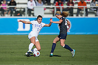 Cary, North Carolina - Sunday December 6, 2015: Casey Martinez (1) of the Duke Blue Devils works to keep the ball away from Emily Ogle (10) of the Penn State Nittany Lions during first half action at the 2015 NCAA Women's College Cup at WakeMed Soccer Park.  The Nittany Lions defeated the Blue Devils 1-0.