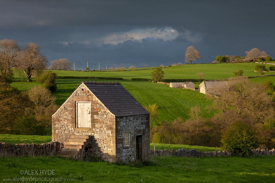 Stone field barn in storm light. Bonsall, Peak District National Park, Derbyshire, UK. April.