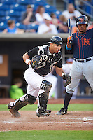 Quad Cities River Bandits catcher Christian Correa (9) retrieves the ball in front of batter David Rodriguez during a game against the Bowling Green Hot Rods on July 24, 2016 at Modern Woodmen Park in Davenport, Iowa.  Quad Cities defeated Bowling Green 6-5.  (Mike Janes/Four Seam Images)