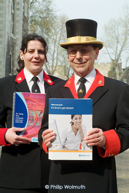 White Tower Warden Anna Nohales and Jewel House Warden Bob Paice, both trade union members, with LearnDirect materials outside the Learning Centre at the Tower of London.