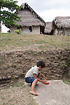 Boy playing with a toy car in the Mayan community of San Miguel, Toledo, Belize