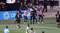 COLUMBUS, OH - DECEMBER 12: Lucas Zelarayan #10 of the Columbus Crew celebrates scoring the third goal of the game with teammates by jumping into the arms of Fanendo Adi #9 of the Columbus Crew during a game between Seattle Sounders FC and Columbus Crew at MAPFRE Stadium on December 12, 2020 in Columbus, Ohio.