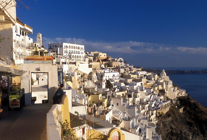 Santorini, Greece, Greek Islands, Fira, Cyclades, Europe, Terraces and resorts in the village of Fira on the steep hillside of Santorini Island overlooking the Aegean Sea.