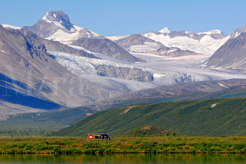A truck passes by Summit Lake and the Gulkana Glacier, along the Richardson Highway, Alaska