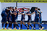 12th September 2020; Craven Cottage, London, England; English Premier League Football, Fulham versus Arsenal; Gabriel of Arsenal celebrates with team mates after he scores for 0-2 in the 49th minute