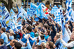 © Joel Goodman - 07973 332324  . 23/05/2011 . Manchester, UK . Tens of thousands of fans congregate in Albert Square and line the streets of Manchester as Manchester City Football Club hold an open-topped bus parade through the city. The team are celebrating winning the FA Cup, their first trophy in 35 years, and for qualifying for next season's Champions League . Photo credit: Joel Goodman