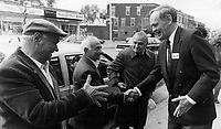 All hands: Liberal Leader Jean Chretien, right, meets citizens on College St. in Toronto's Little Italy yesterday. He urged Canadians to set aside their dislike of Prime Minister Brian Mulroney and Vote Yes in the Pan canadian referendum<br /> <br /> Photo : Boris Spremo - Toronto Star archives - AQP