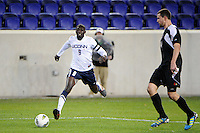 Stephane Diop (9) of the Connecticut Huskies. Connecticut defeated Louisville 1-0 during the first semifinal match of the Big East Men's Soccer Championships at Red Bull Arena in Harrison, NJ, on November 11, 2011.