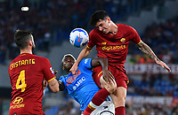 Calcio, Serie A: AS Roma vs SSC Napoli, Olympic stadium, October 24, 2021.<br /> Roma's Roger Ibanez (R) in action with Napoli's Victor Osimhen (C) and Roma's Bryan Cristante (L) during the Italian Serie A football match between Roma and Napoli at Rome's Olympic stadium, on , October 24, 2021. <br /> UPDATE IMAGES PRESS/Isabella Bonotto