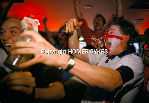 UK football fans World Cup 1998. Supporters watching a penalty shoot out between England and Argentina that decided the game, Argentina won 4–3 after two English kicks were saved. England was  knocked out of the World Cup. Sports Bar, London 1990s UK