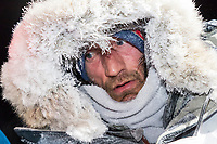 Nick Petit is frosted up at the finish line in Nome, Alaska early on Wednesday morning March 14th as places 2nd in the 46th running of the 2018 Iditarod Sled Dog Race.  <br /> <br /> Photo by Jeff Schultz/SchultzPhoto.com  (C) 2018  ALL RIGHTS RESERVED