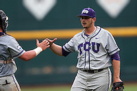 TCU Horned Frogs pitcher Riley Ferrell (12) is congratulated by catcher Evan Skoug (9) after recording the save against the LSU Tigers in the NCAA College World Series on June 14, 2015 at TD Ameritrade Park in Omaha, Nebraska. TCU defeated LSU 10-3. (Andrew Woolley/Four Seam Images)