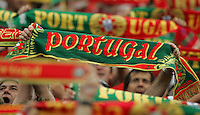Portuguese scarves are held aloft by fans during the start of the game.   Portugal defeated England on penalty kicks after playing to a 0-0 tie in regulation in their FIFA World Cup quarterfinal match at FIFA World Cup Stadium in Gelsenkirchen, Germany, July 1, 2006.
