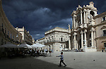 Syracuse Cathedral and Town Hall, Piazza Duomo, Ortygia, Syracuse, Sicily. Syracuse is famous for its rich Greek history, culture, amphitheaters, architecture, and as the birthplace of Archimedes. This 2,700 year-old city played a key role in ancient times, when it was one of the top powers of the Mediterranean world.