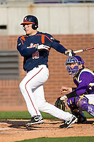 Steven Proscia #19 of the Virginia Cavaliers follows through on his swing versus the East Carolina Pirates at Clark-LeClair Stadium on February 19, 2010 in Greenville, North Carolina.   Photo by Brian Westerholt / Four Seam Images