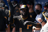 Pittsburgh Pirates Anthony Alford (6) high fives teammates after hitting a home run during a Major League Spring Training game against the Toronto Blue Jays on March 1, 2021 at TD Ballpark in Dunedin, Florida.  (Mike Janes/Four Seam Images)